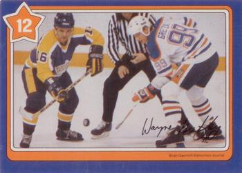 1982-83 Neilson's Gretzky #12 The Hook Check/(with Marcel Dionne) Front